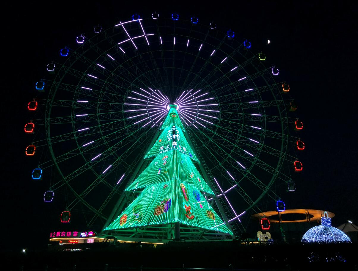 the ferris wheel qindao eye decorated as christmas tree shining upon the west coast